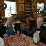 Resident Pat Holmes, and Edith Gorman enjoying cider and donuts inside Wickham Farms country market.