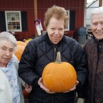 Residents Arlene Howard, Marie Licata, and Edith Gorman picking out the perfect pumpkin.
