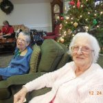 Gloria and Anne enjoying our Annual Christmas Eve Party